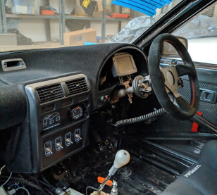 Parts fitted to my project EP82 Toyota Starlet. Pictured here are my switch panel, steering wheel button panel, dash display, and button guards.