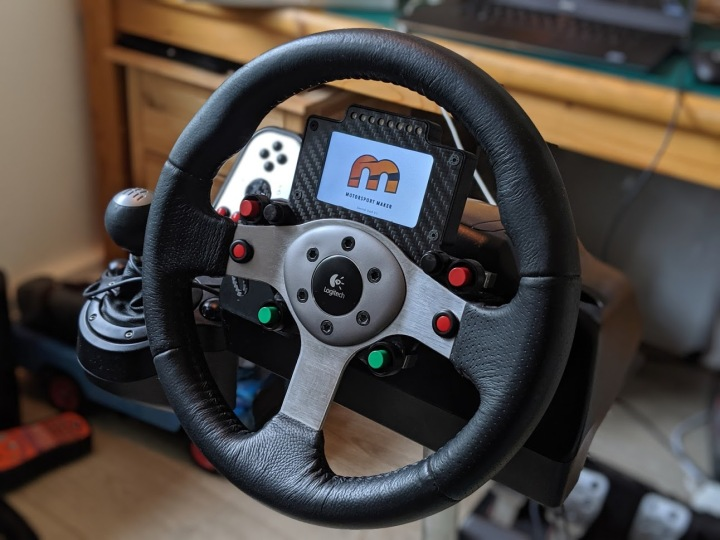 Logitech G25 Carbon Button Panel & Display. More here: https://motorsportmaker.com/logitech-g25-carbon-button-panel-and-nextion-display/