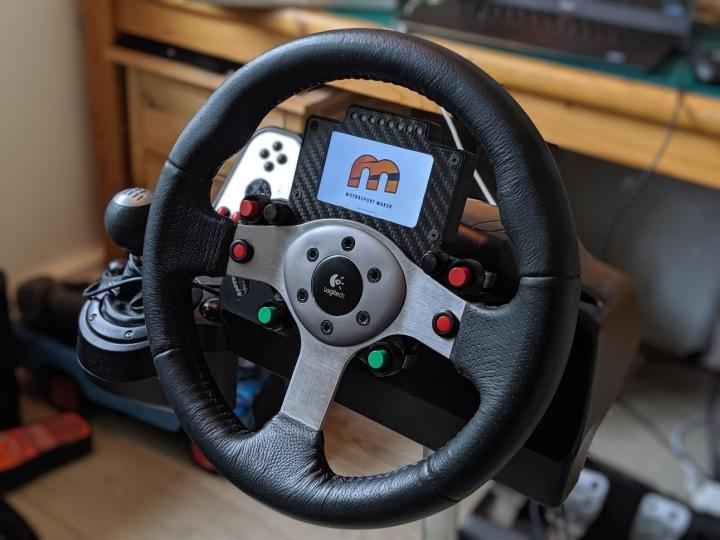 Logitech G25 Carbon Button Panel & Display. More here: https://motorsportmaker.com/logitech-g25-carbon-button-panel-and-nextion-display/